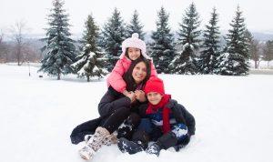 Family in snow A\J AlternativesJournal.ca